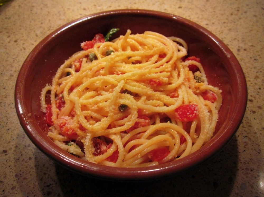 Spaghetti alla Carrettiera, topped with Parmesan
